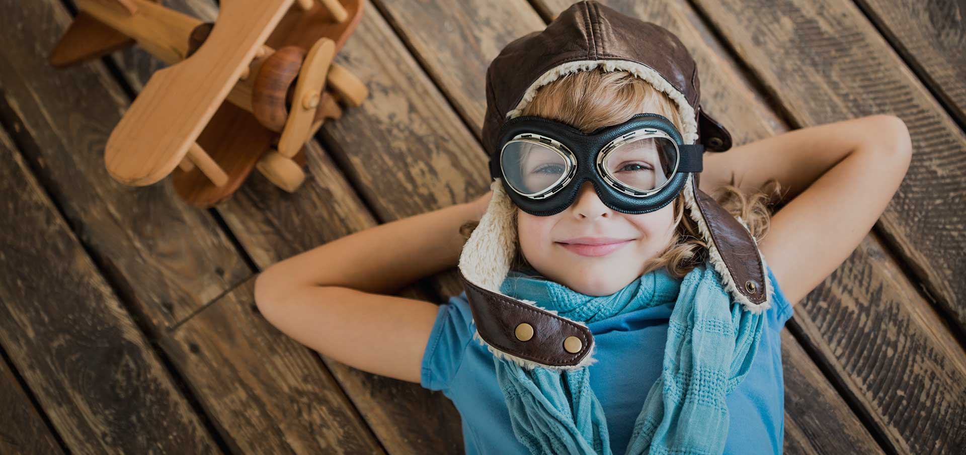 Jonathan Sierk Children's Dentistry | Happy child with aviator cap
